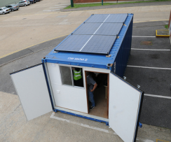 shipping container contains solar powered internet cafe in Africa